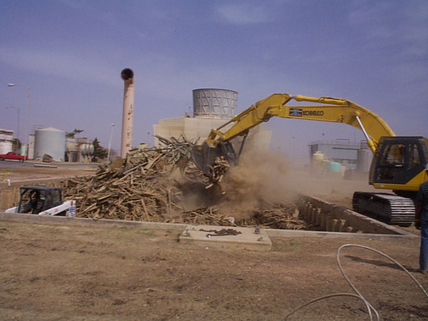Final wood tower demolition on existing basin.
